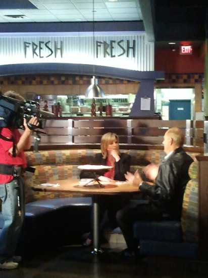 Dragon Den's Jim Treliving chats with BT Vancouver's Dawn Chubai at where else? Boston Pizza.