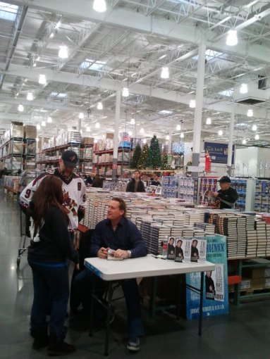 Former NHL-er Jeremy Roenick signs copies of his book J.R.