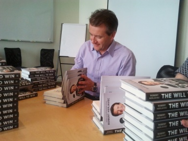 Former Dragon's Den star Robert Herjavec signs hundreds of books before his Chapter Robson event.